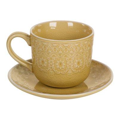 Taza de té con plato mostaza
