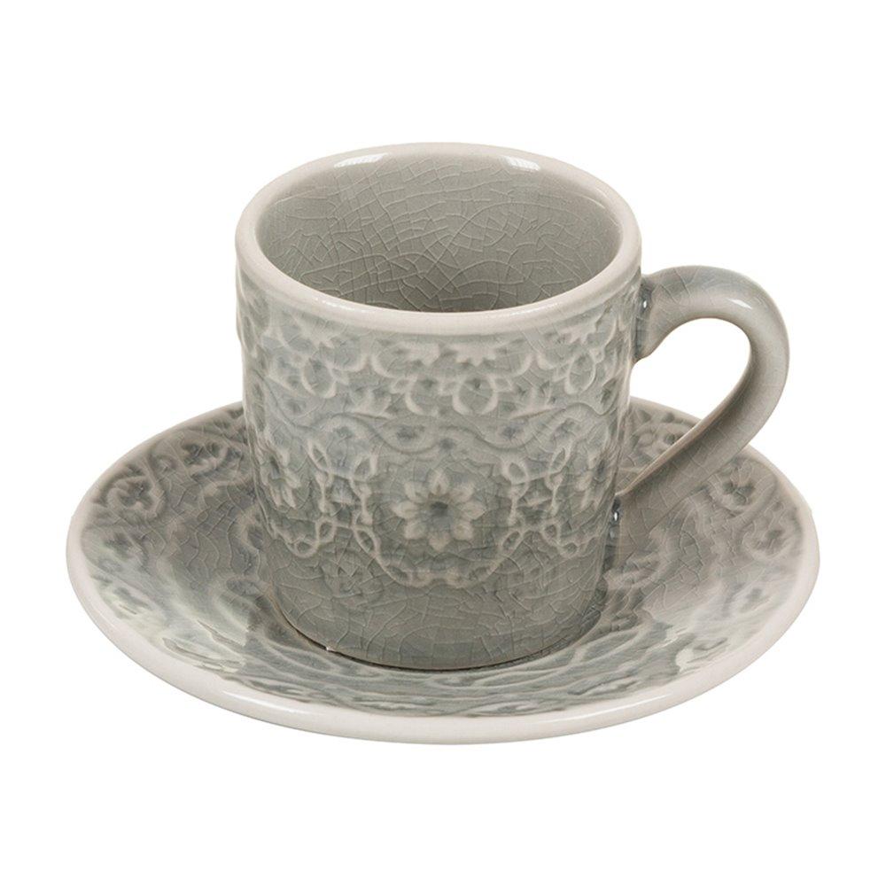 Taza de café con plato gris