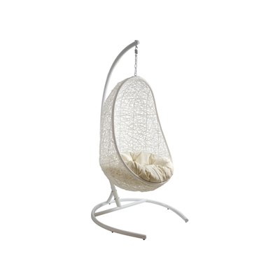Hanging basket chair with white cushion