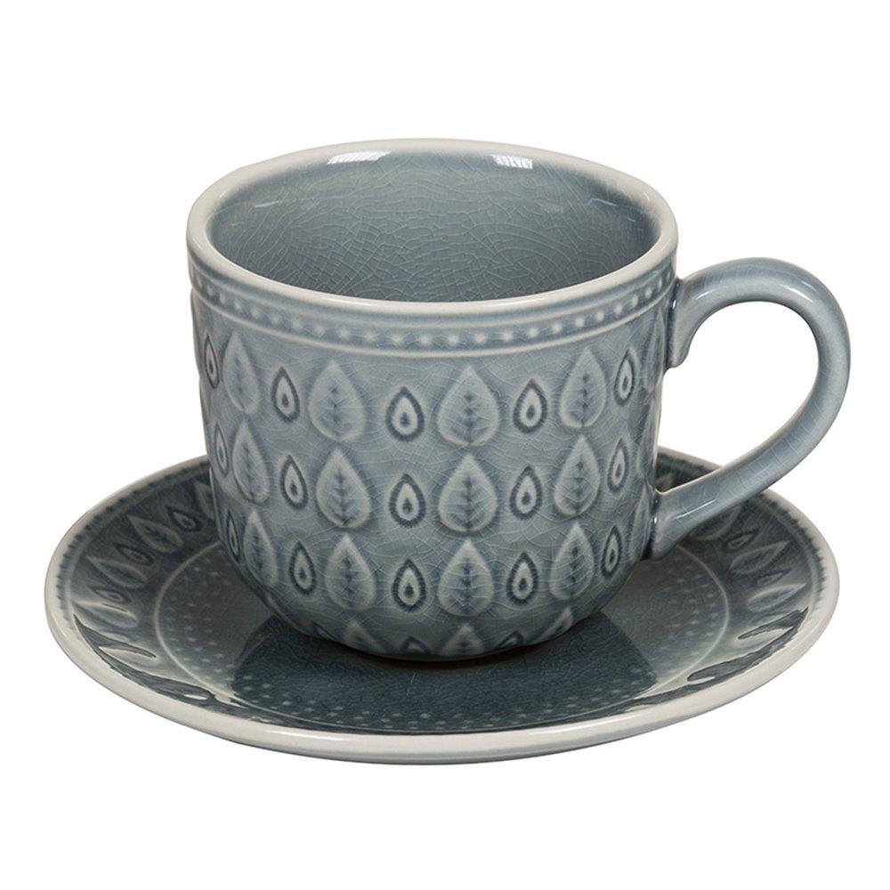 Taza de café con plato natural azul