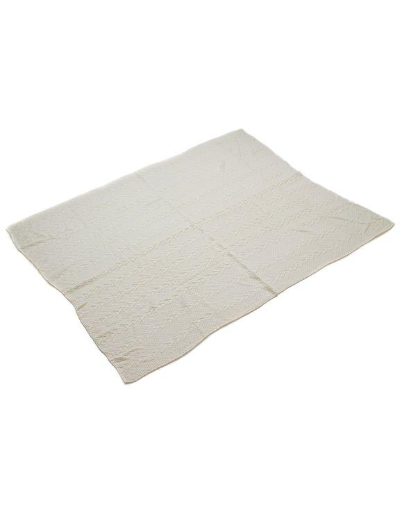 Weiße gestrickte Decke
